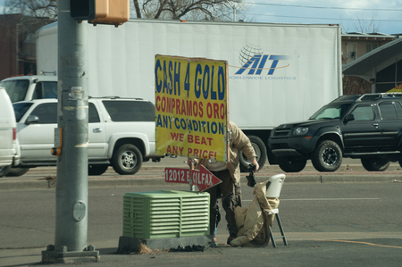 colfax: Selling gold on Colfax Blvd in Denver, Co Editorial