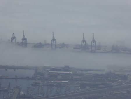 capetown: Port of Capetown looking down through cloud cover from Table Mountain
