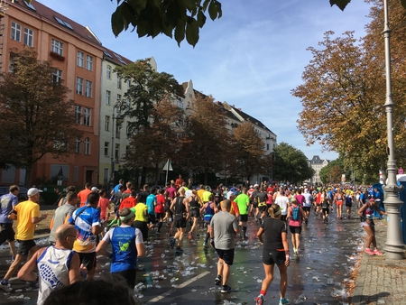 Berlin, Germany - September 16, 2018: People running at Berlin Marathon over tons of Empty Plastic Cups Éditoriale
