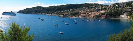 Panoramic view of Villefranche-sur-Mer in the French Riviera, France, and the Mediterranean sea / Cote d'Azur