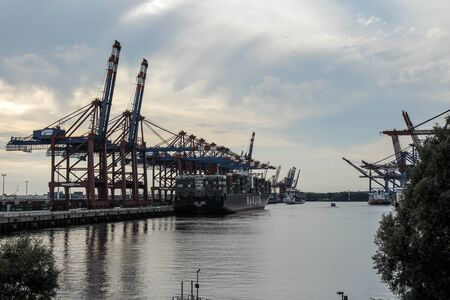 HAMBURG, AUGUST 2013: Wide Shot of a large Container Ship and big Container Cranes (Gantry Cranes) in the port of Hamburg.