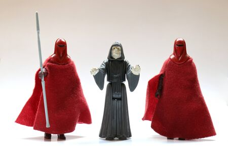BERLIN - AUGUST 29, 2019: Vintage Star Wars Palpatine (Darth Sidious) The Emperor and Royal Guard Action Figures from Kenner Toys on White. This was released with the Movie