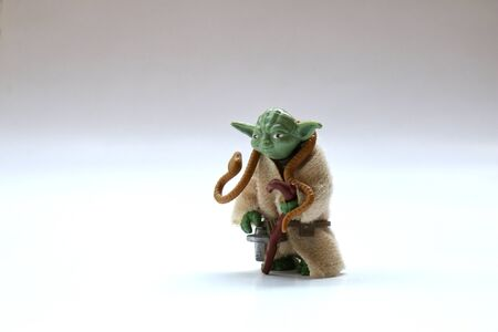BERLIN - AUGUST 29, 2019: Vintage Star Wars Yoda Action Figure from Kenner Toys with Snake on White. This was released with the Movie