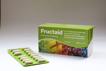 BERLIN - AUGUST 30, 2019: Box of Fructaid Capsules and a Blister Pack. A medicine that helps people with Fructose Intolerance / Malabsortion to digest fruit sugar that is in fruits, vegetables and many other food. Editöryel