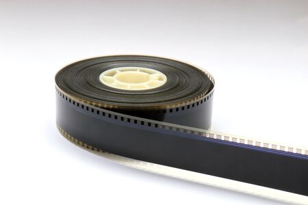 Small 35mm Movie Trailer Film Roll on a Bobby. This is a 2-3 minute long film strip. You can see the perforations with the digital soundtrack inbetween and the analog soundtrackt next to it.