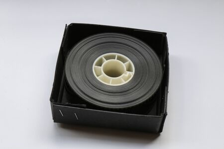 Small 35mm Movie Trailer Film Roll on a Bobby in a box. This is a 2-3 minute long film strip shipped to a Movie Theatre.