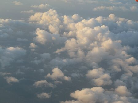 Beautiful and dreamy Clouds and Cloud Formations photographed from above during sunset / dawn.