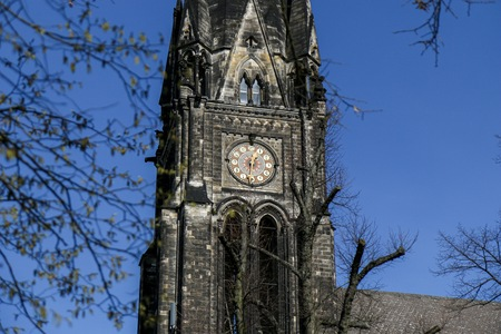 BERLIN - MARCH 3, 2014: Church Spire with clock of the neo-gothic Kirche am Suedstern in Kreuzberg. Was build 1894 to 1897.