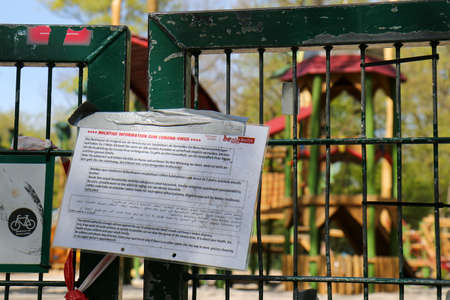BERLIN, GERMANY - APRIL 16, 2020: Closed Playground in Public Park Hasenheide due to Corona Pandemic (Covid 19) lockdown. Notice by the City of Berlin and barrier tape.