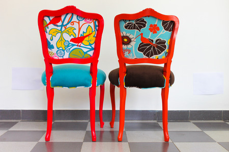 Two Chairs in Red and Orange Stock Photo
