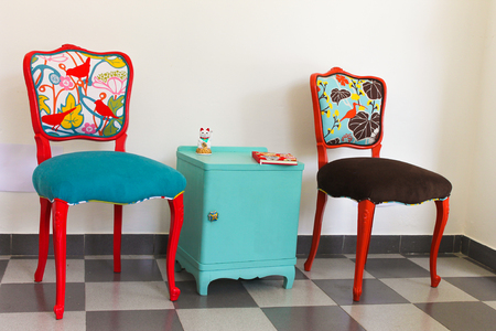 Two French Vintage Chairs in Red and Orange and a Bedside Table