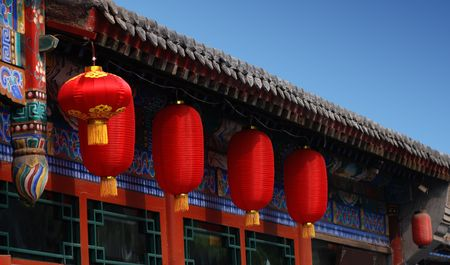 red lanterns in front of an chinese traditional building