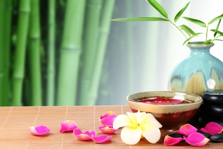 Spa still life with rose petals and bamboo leaf Reklamní fotografie