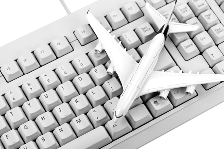 Model plane on computer keyboard. Reklamní fotografie