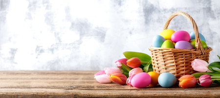 Easter eggs and tulip flower on wooden table Reklamní fotografie