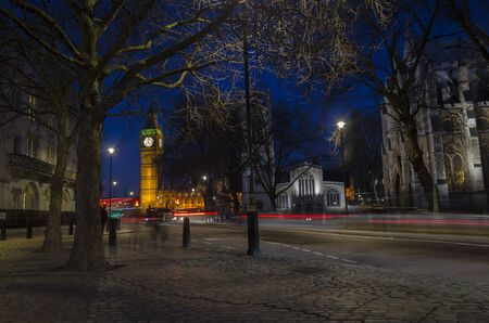 London, England, February 16th, 2017: Long exposure car movement next to Big Ben at Night in London City Imagens