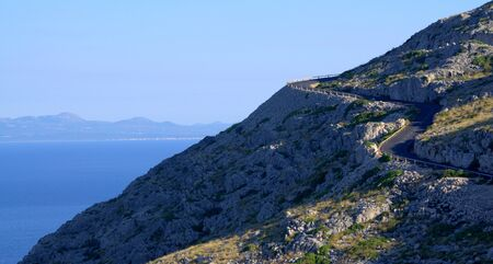 Steep road next to the mediterranean sea. Road to Cape Formentor Lookout, Mallorca Island, Spain.