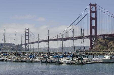 San Francisco, USA, June 27th 2019: Golden Gate Bridge and sailing boats on the front in a sunny day