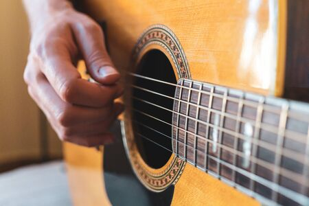 Men Playing Acoustic Guitar Closeup Photography. Vintage style.