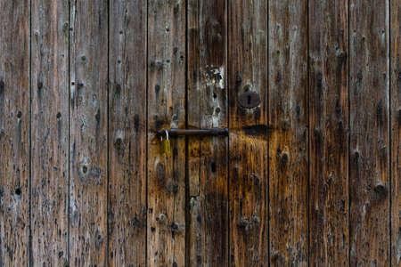 Old wooden door texture with a lock. Stock fotó
