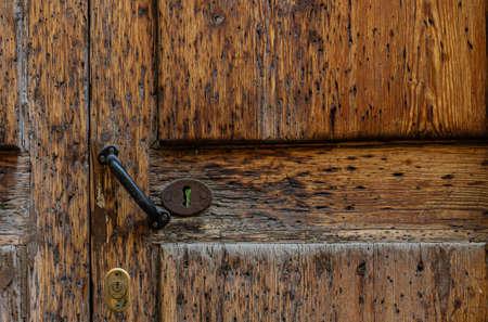 Old wooden door with iron lock. Dark wood texture. Stock fotó