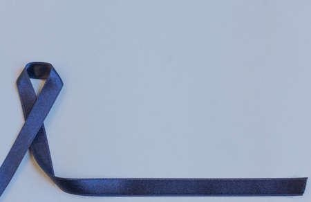 Dark blue ribbon a symbol to raise awareness.