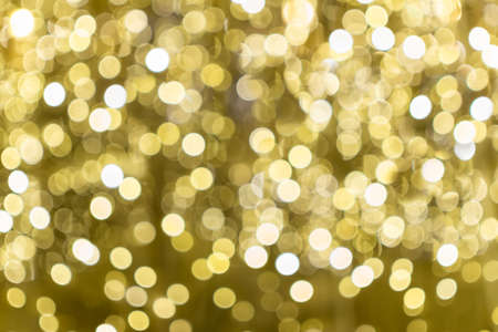 Blurred background of yellow Christmas lights.