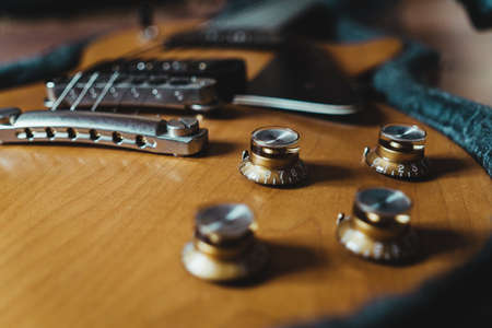 Volume and tone control knobs of electric guitar.
