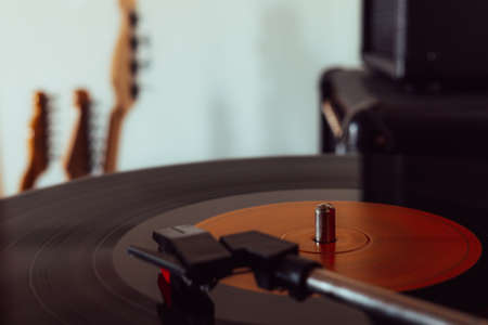 Close up of a Turntable playing vinyl record.