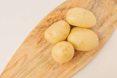 Potatoes on vintage wooden cutting board