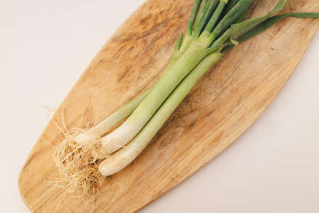 Organic and fresh green onions on cutting board