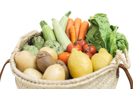 Selective focus of organic and fresh vegetables in a basket against white background. 版權商用圖片 - 166849853