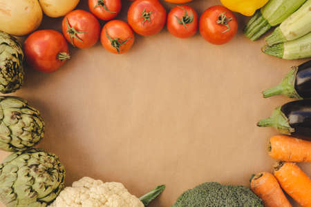 Assorted colorful vegetables and fruits arranged in a circle, copy space for text in the middle.