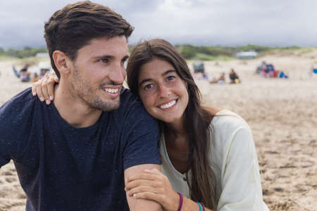 Portrait of a young latin couple at the beach