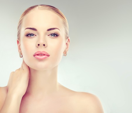 Beautiful  Woman with Clean Fresh Skin close up . Skin care face . Cosmetology and makeup