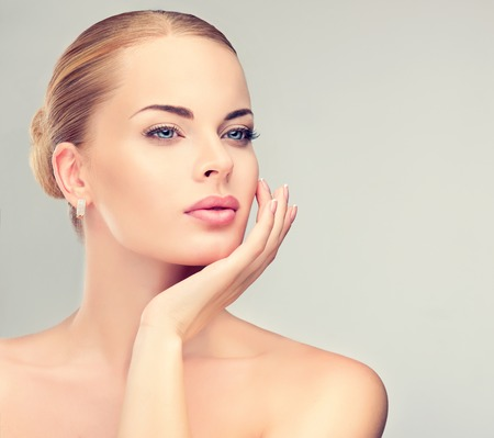 naturally: Beautiful  Woman with Clean Fresh Skin close up . Skin care face . Cosmetology and makeup