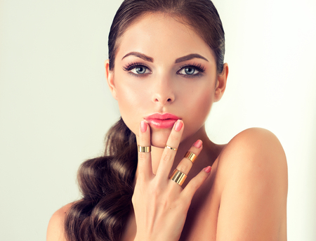 silver jewelry: fashion woman with jewelry set . girl with   fashionable jewelry , earrings  and ring . Stock Photo