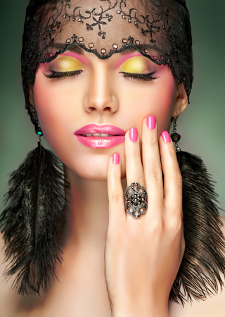 hairclip: Trendy bright pinkand ellow makeup . Stylish model girl with pink manicure nails Stock Photo