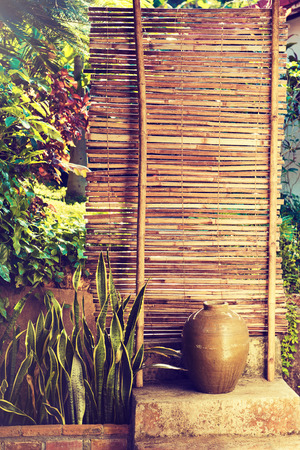 zen interior: Bamboo fence with plants . plants on a bamboo wall .
