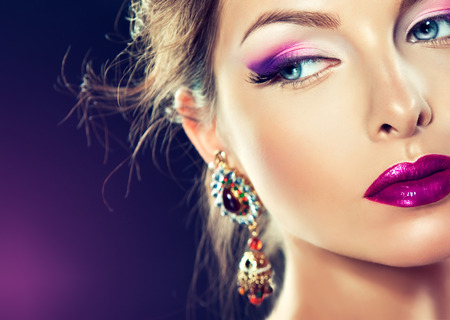 visagiste: Beautiful   girl model with fashion make-up and purple manicure on nails. Jewelry and cosmetics.