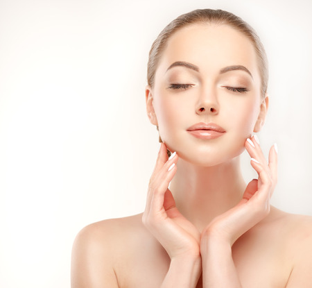 beauty: Yong, gorgeous model touch her face and demonstrate freshness and clean womans face skin. Skin care and Cosmetology.