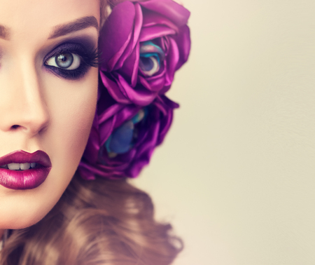 Beautiful model with flower wreath on his head . Makeup smoky eyes . Summer girl with trendy makeup .