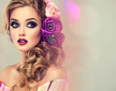 smoky eyes: Beautiful model with flower wreath on his head . Makeup smoky eyes . Summer girl with trendy makeup .