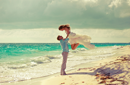 Bride, whose came from the sky.Young beautiful couple get married on the beach on a tropical island . Happy newlyweds . Stok Fotoğraf