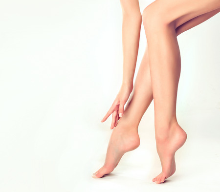 Beautiful well-groomed female legs . Foot care . Epilation and depilation of hair on the feet .