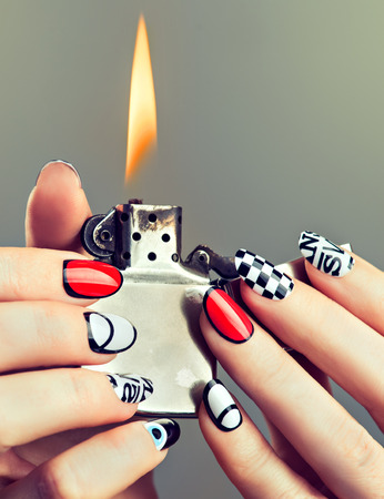 the well groomed: Well groomed womans hands with original modern designed manicure on finger nails.