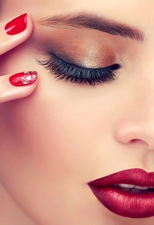 Luxury fashion style, manicure nail , cosmetics and makeup . Red lips and long eyelashes.