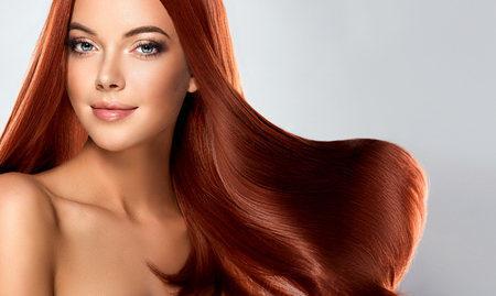 Beautiful model girl with shiny brown straight long hair . Care and hair products Stockfoto