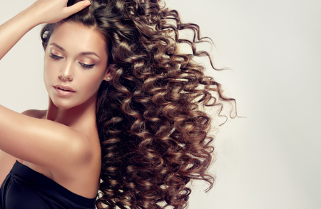 Tensed, spring-like curls on the hair.Incredibly dense, wavy,and shiny hair.