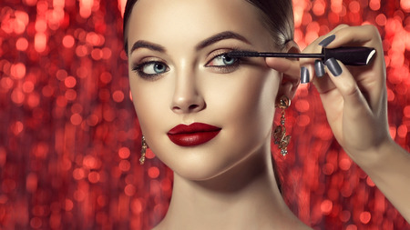 Make up artist is working with face of perfect model. Cosmetic and make up. Stock Photo